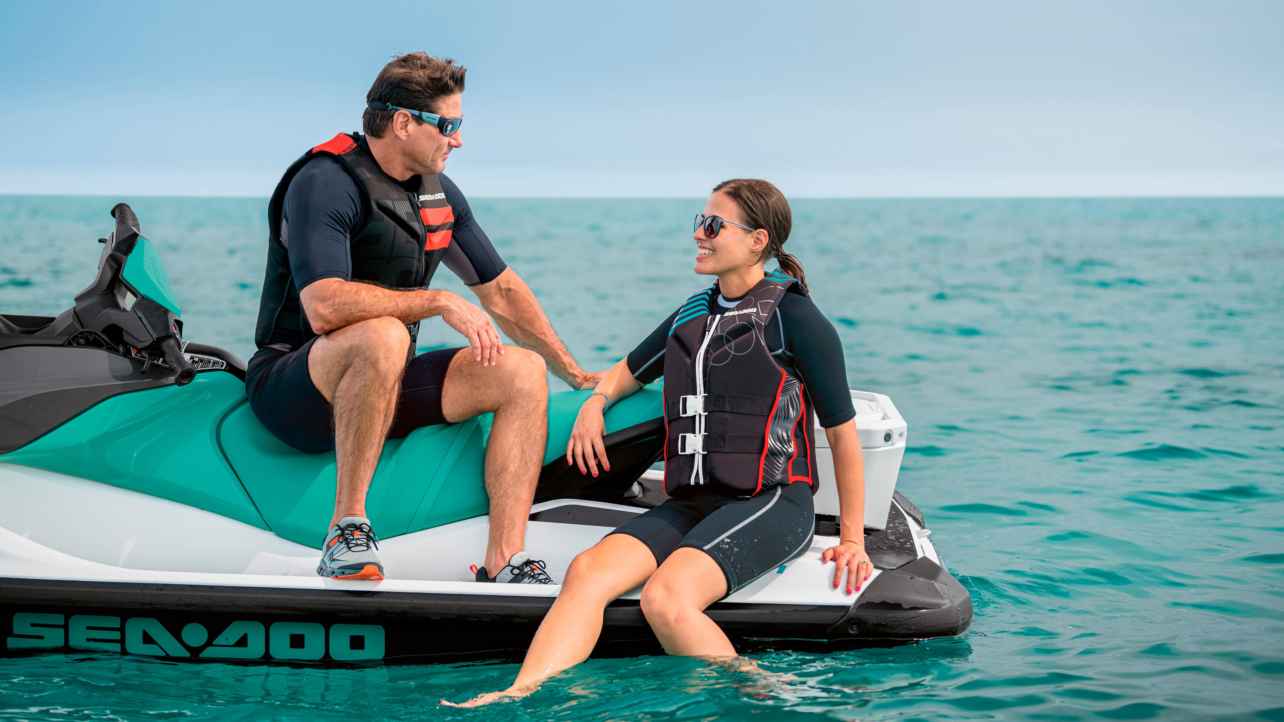 Couple chatting on Sea-Doo watercraft