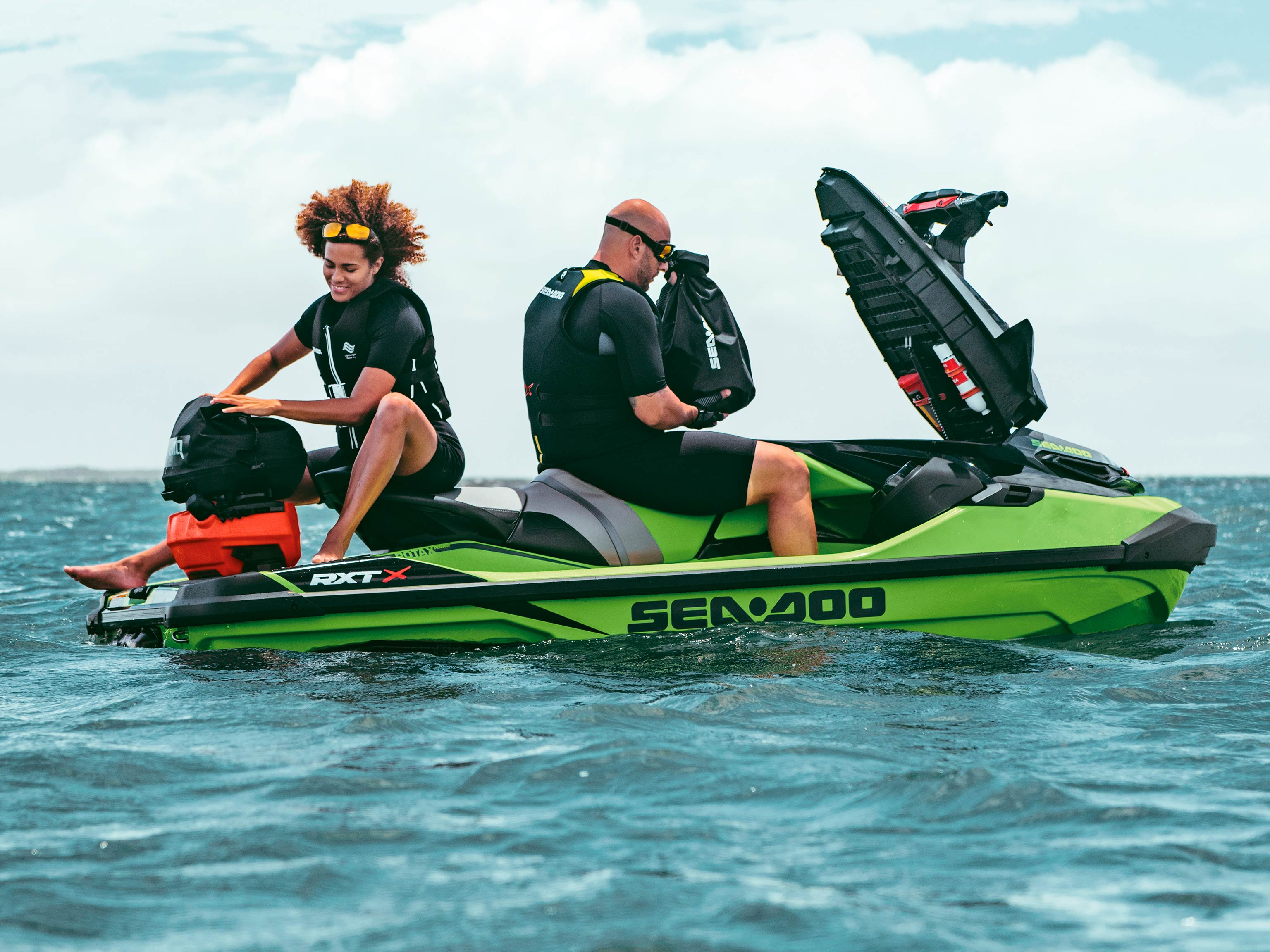 Couple on a Sea-Doo RXT-X with Front storage open
