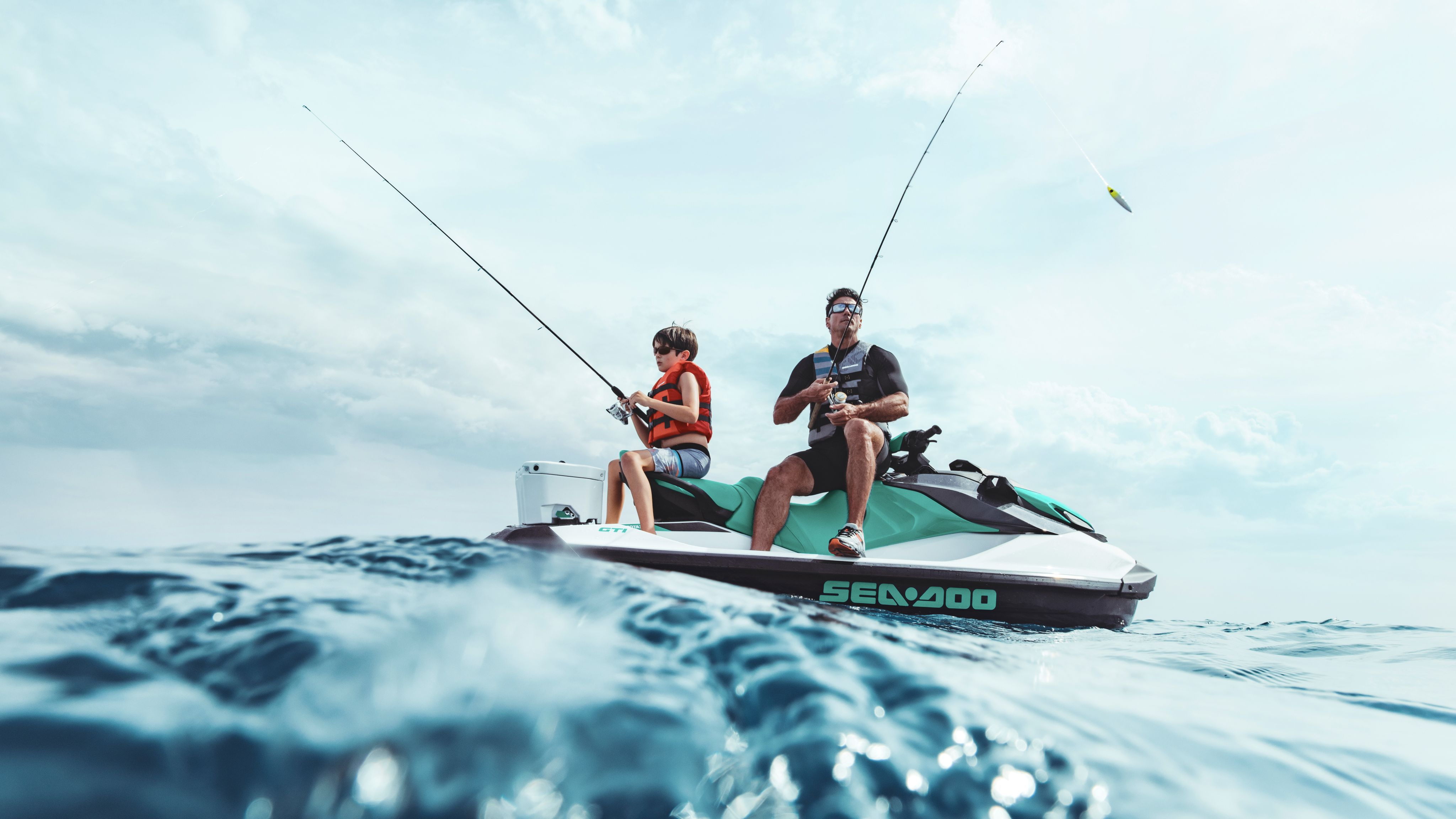Father and son fishing on a Sea-Doo