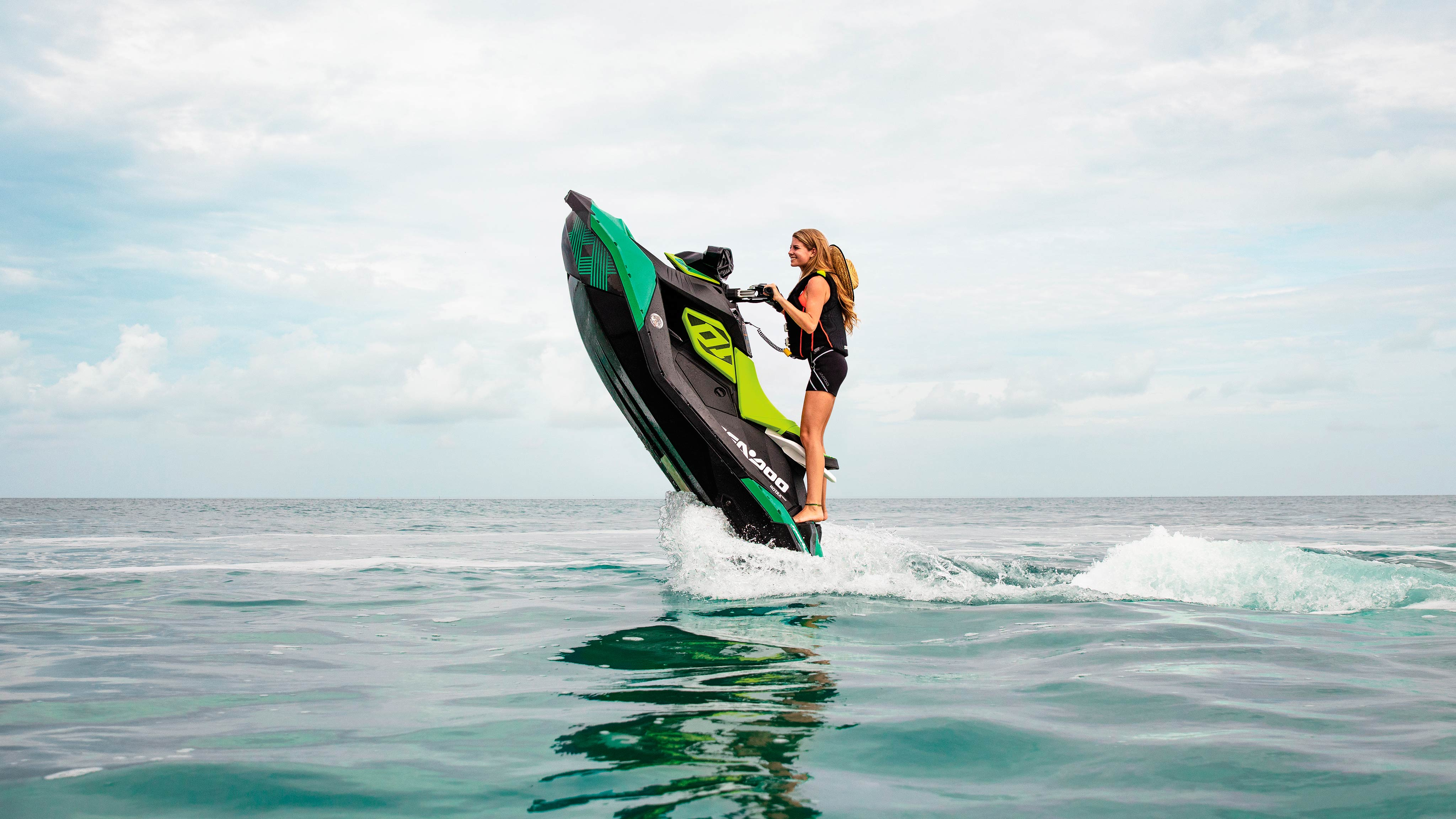 Girl doing a candle on a Sea-Doo SPARK TRIXX