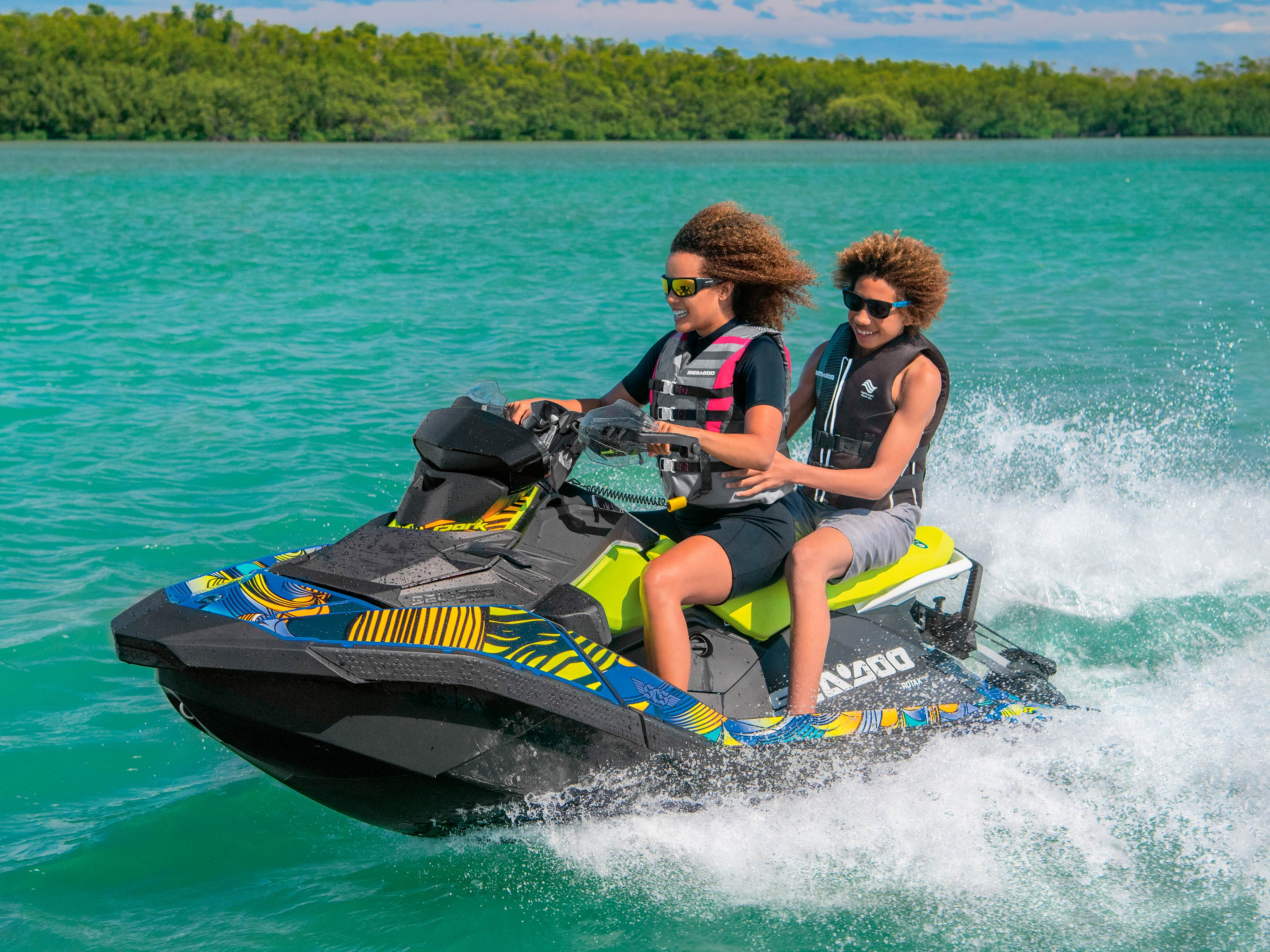 Mother and son riding a Sea-Doo SPARK