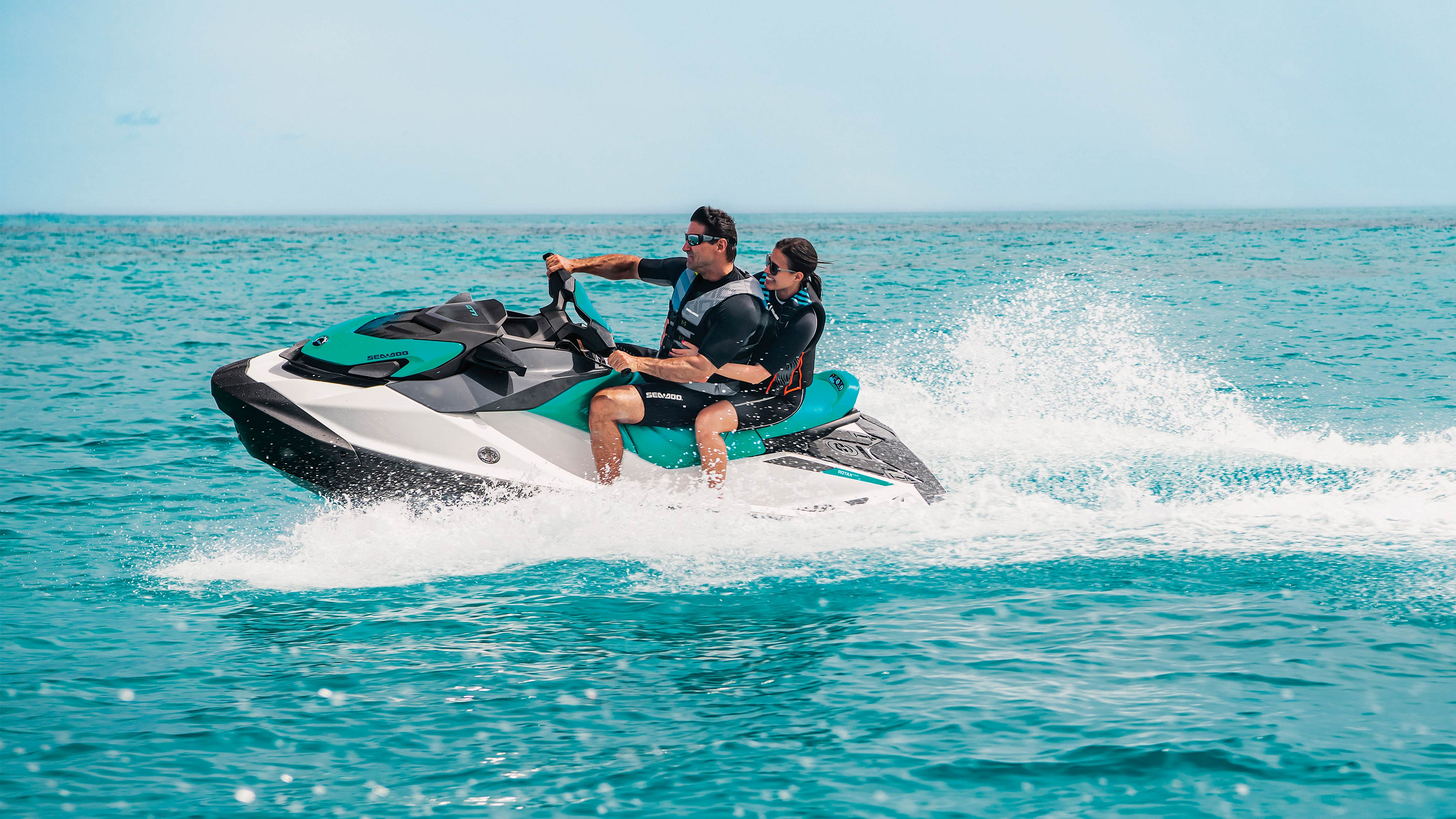 Couple riding on a Sea-Doo GTI