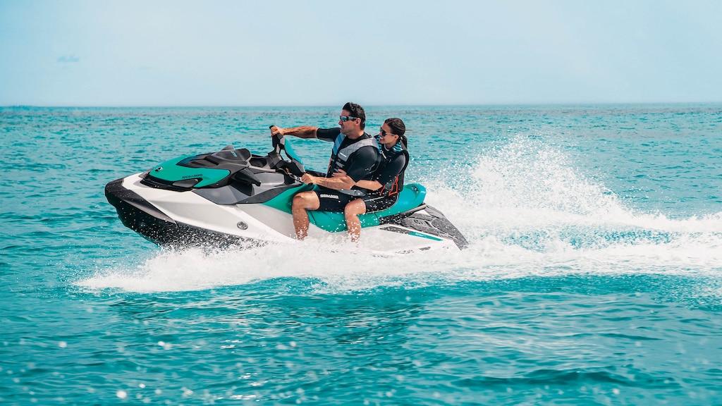 Couple riding on a Sea-Doo GTI