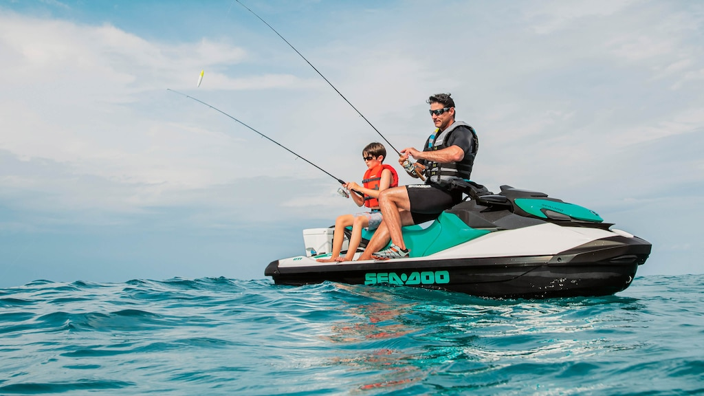 Father and son fishing on a Sea-Doo GTI