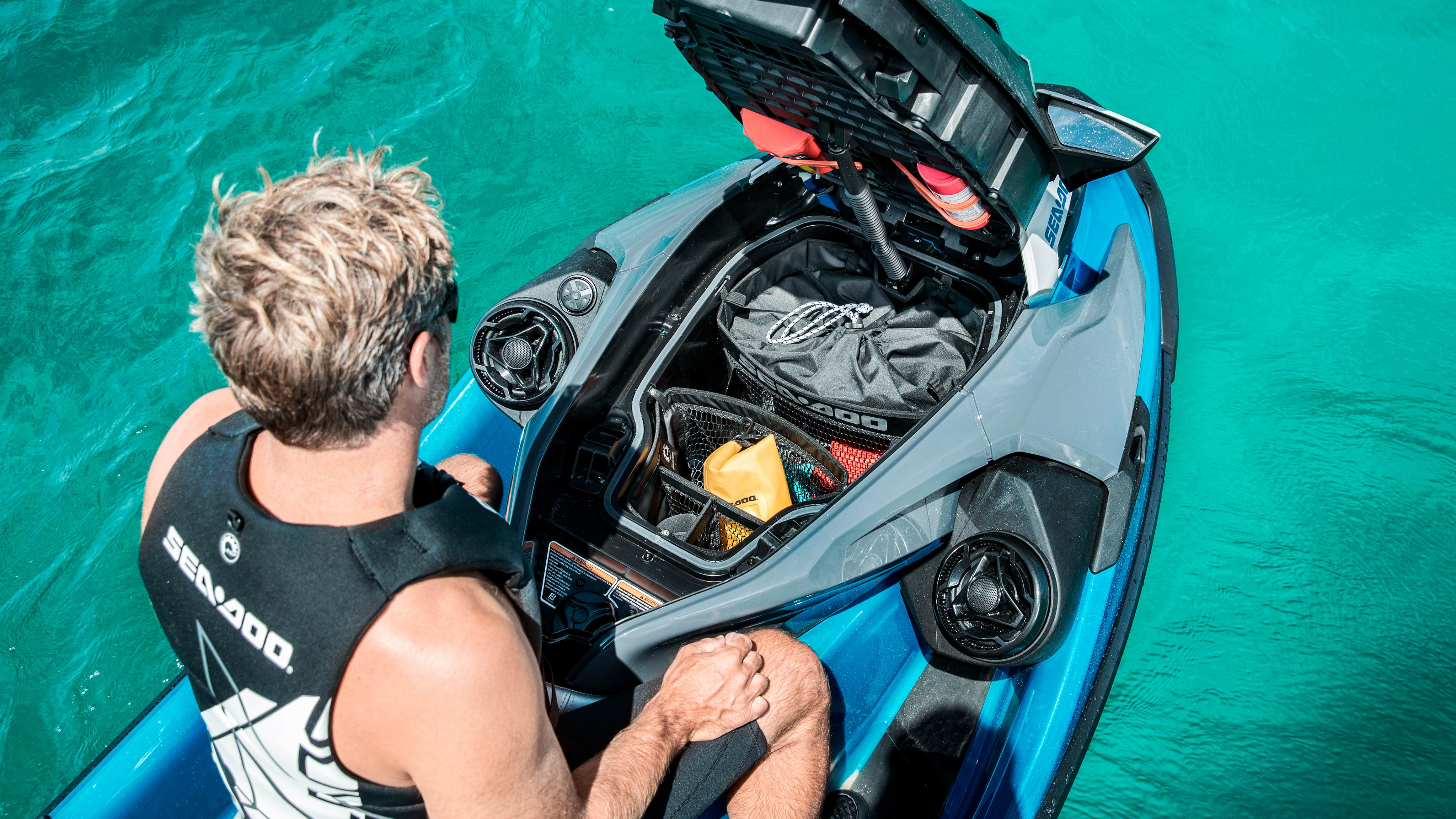 Man sitting on Sea-Doo GTX with front storage
