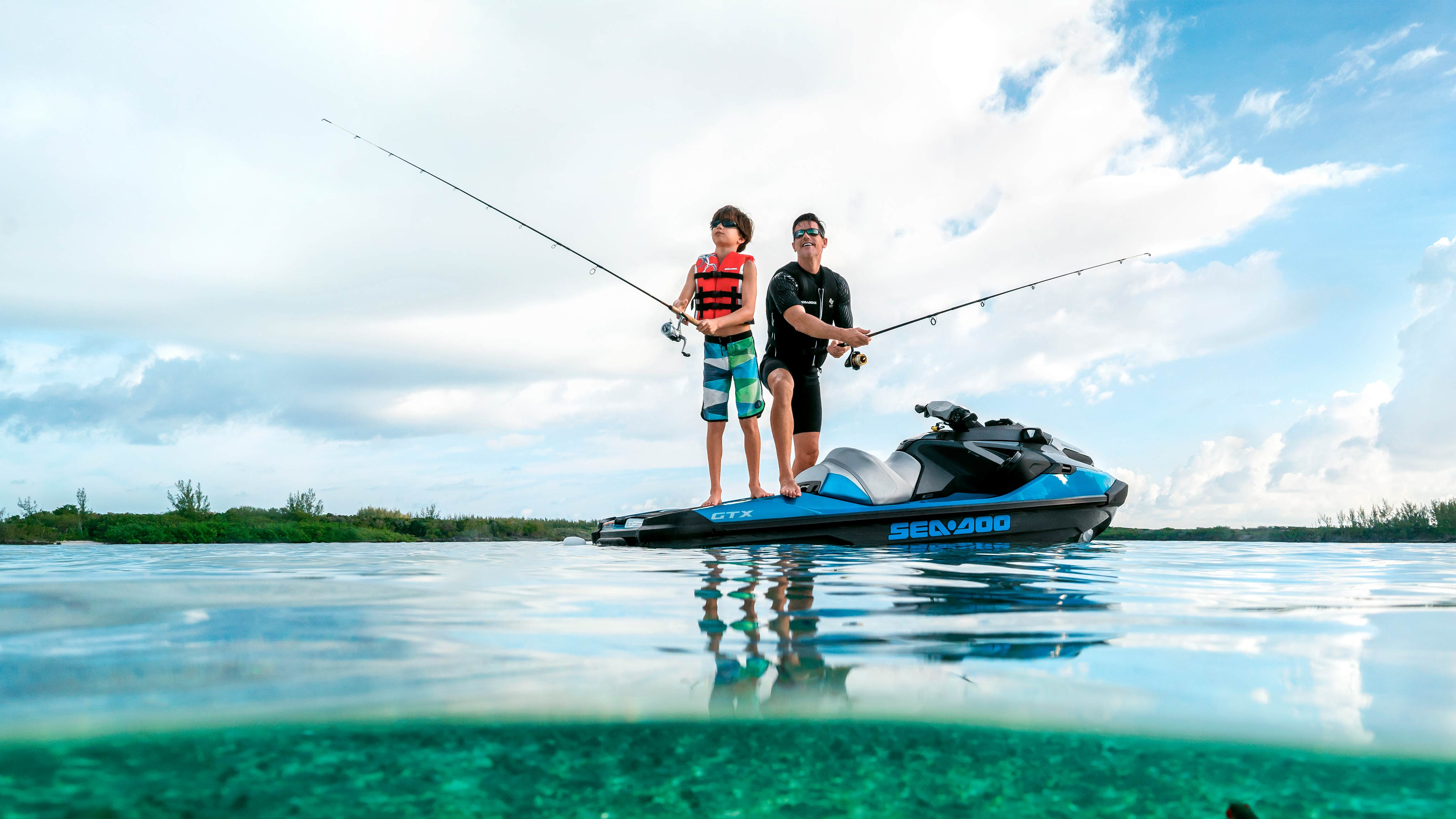 Father and son fishing on a Sea-Doo GTX