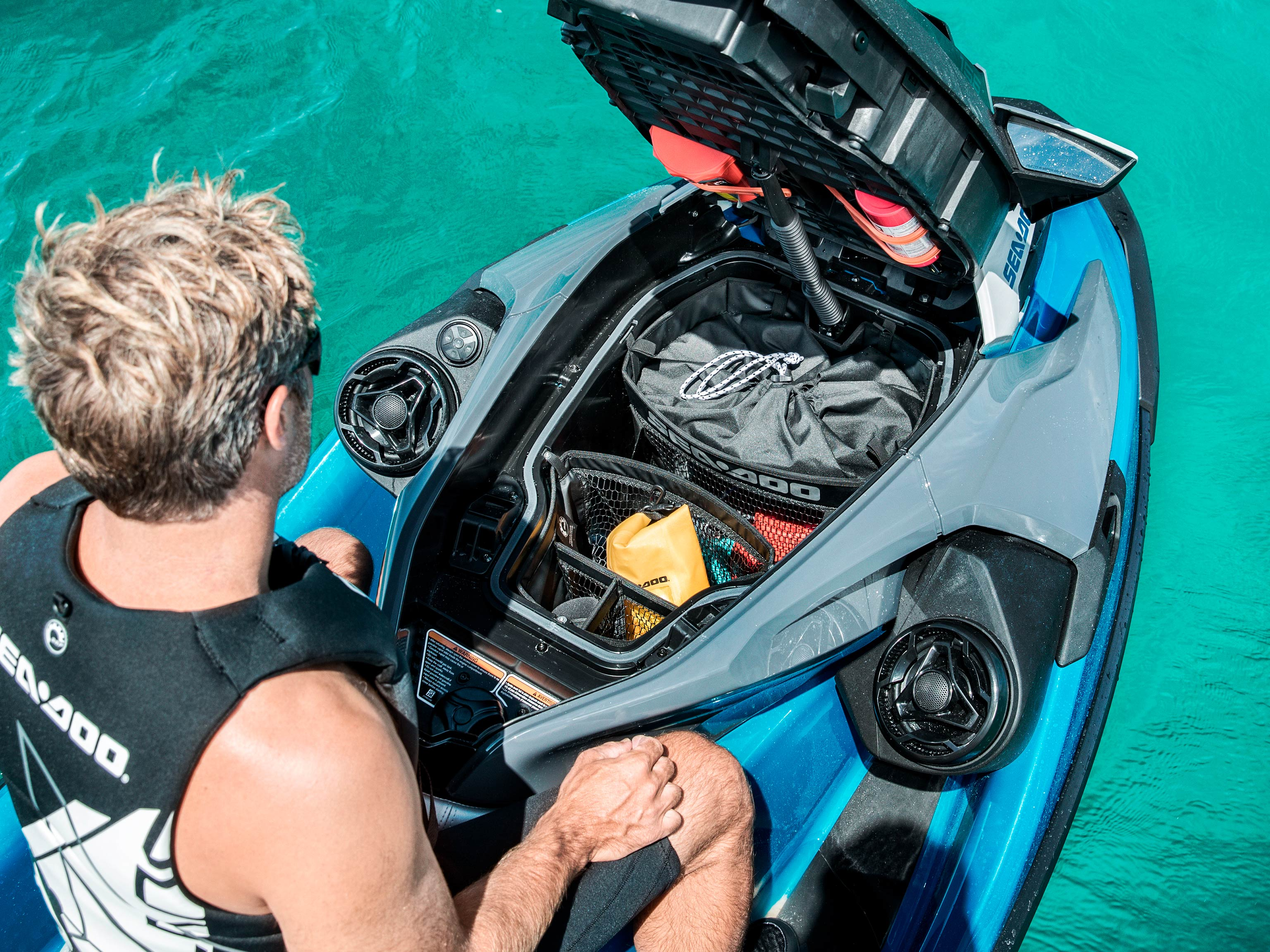 Man on his Sea-Doo GTX with front storage open