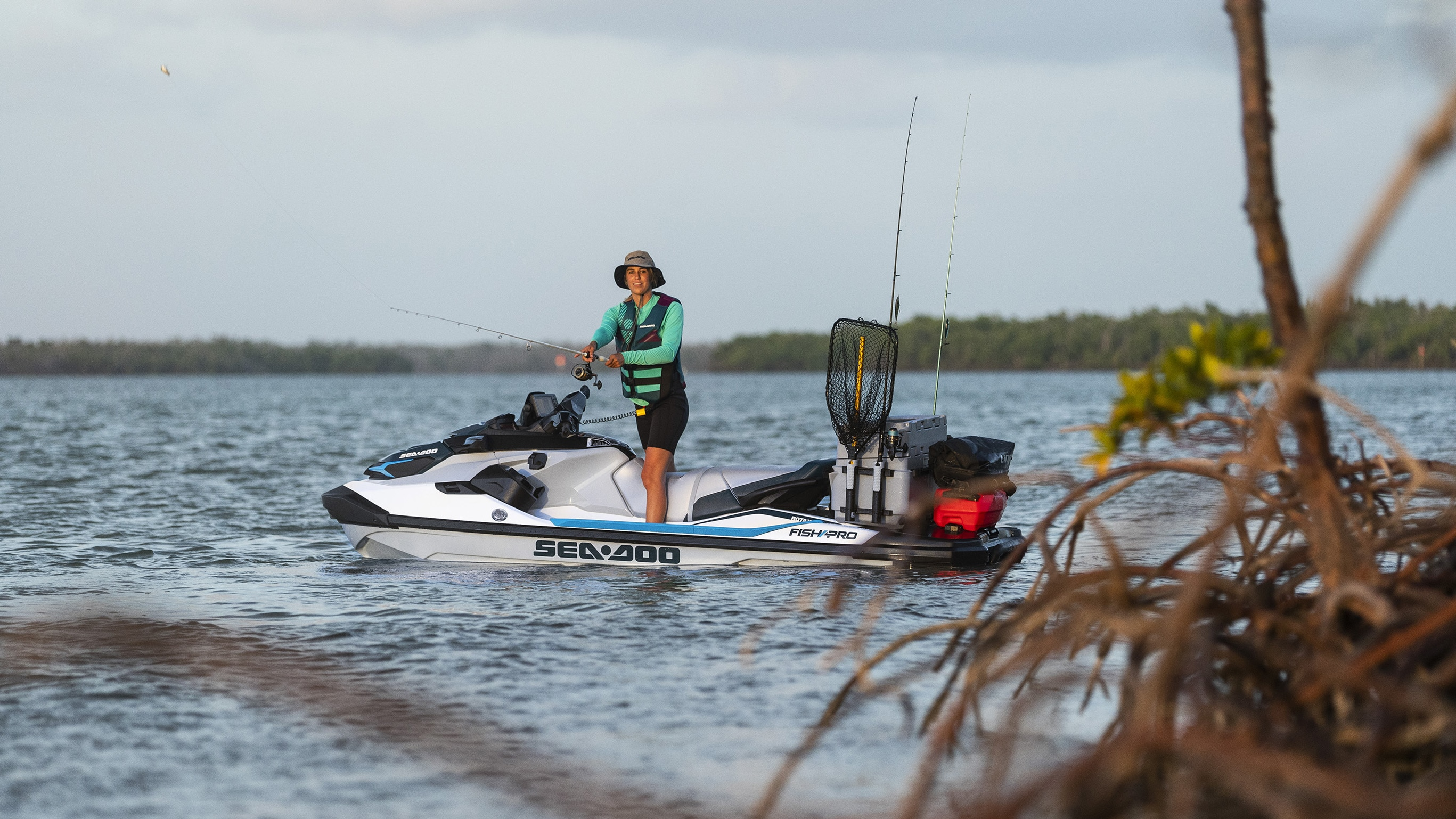 Woman fishing on her Sea-Doo Fish Pro with LinQ accessories