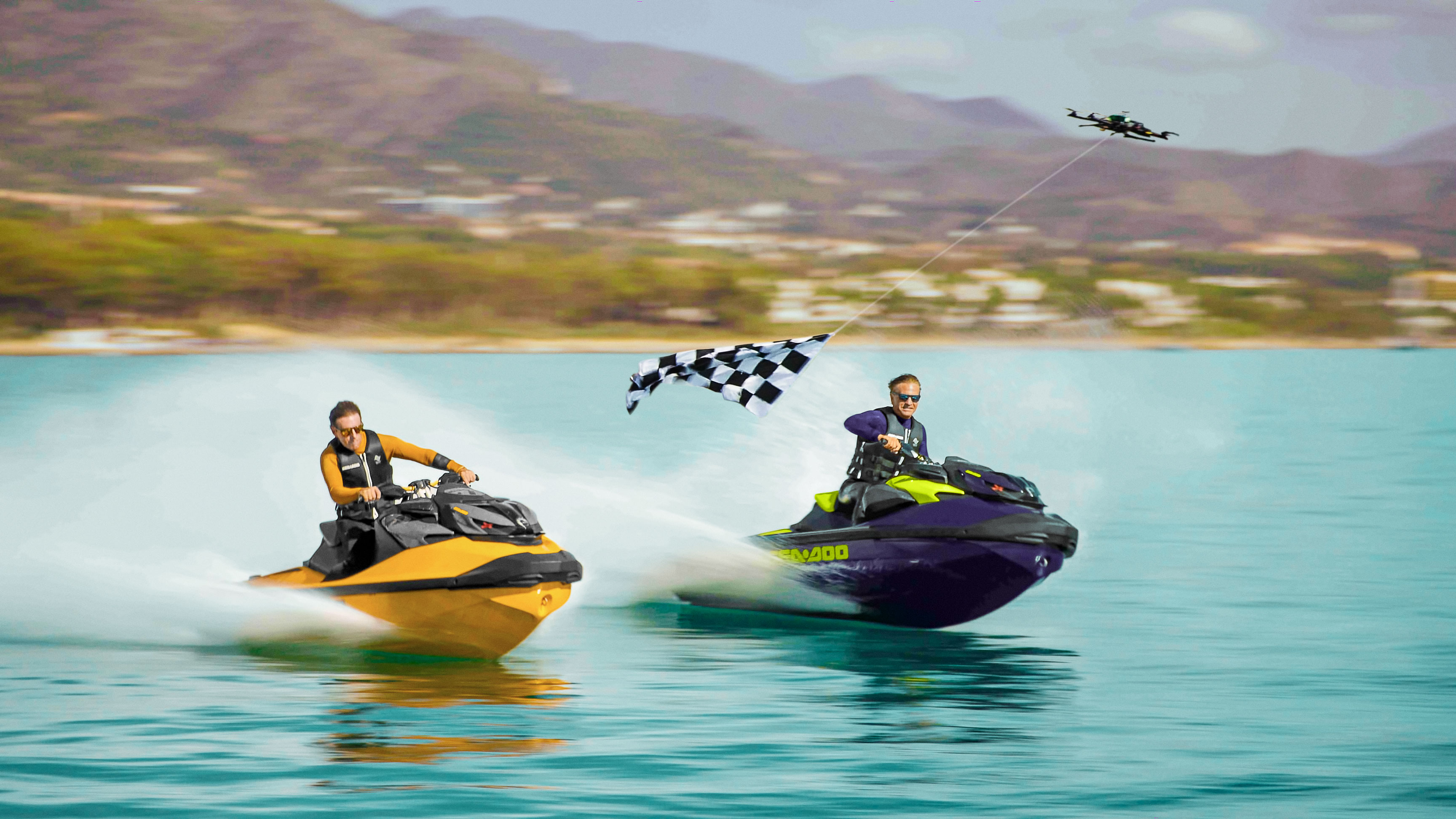 2 men racing with Sea-Doo RXP-X