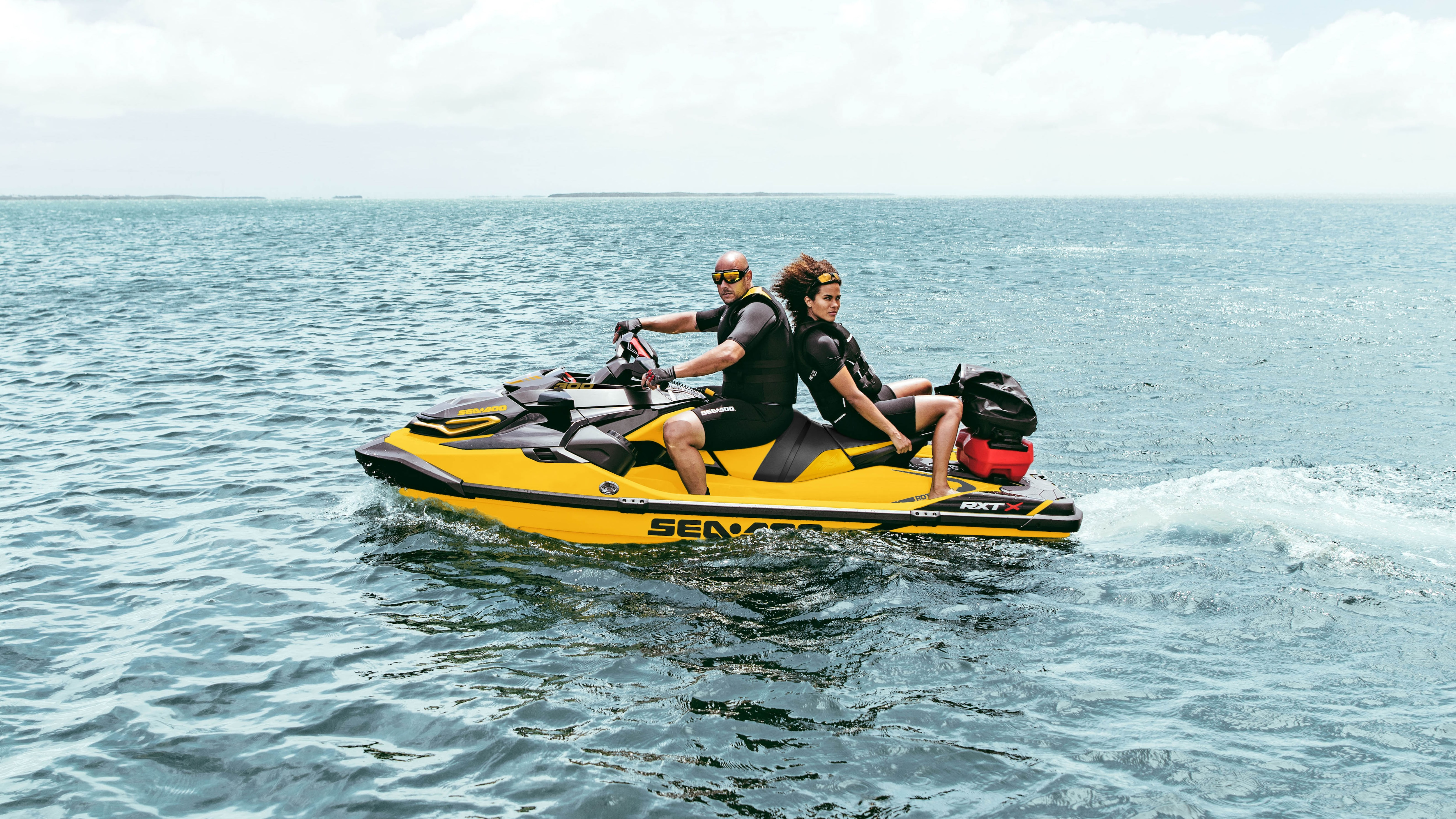 Couple riding a Sea-Doo RXT-X with the Cargo LinQ system