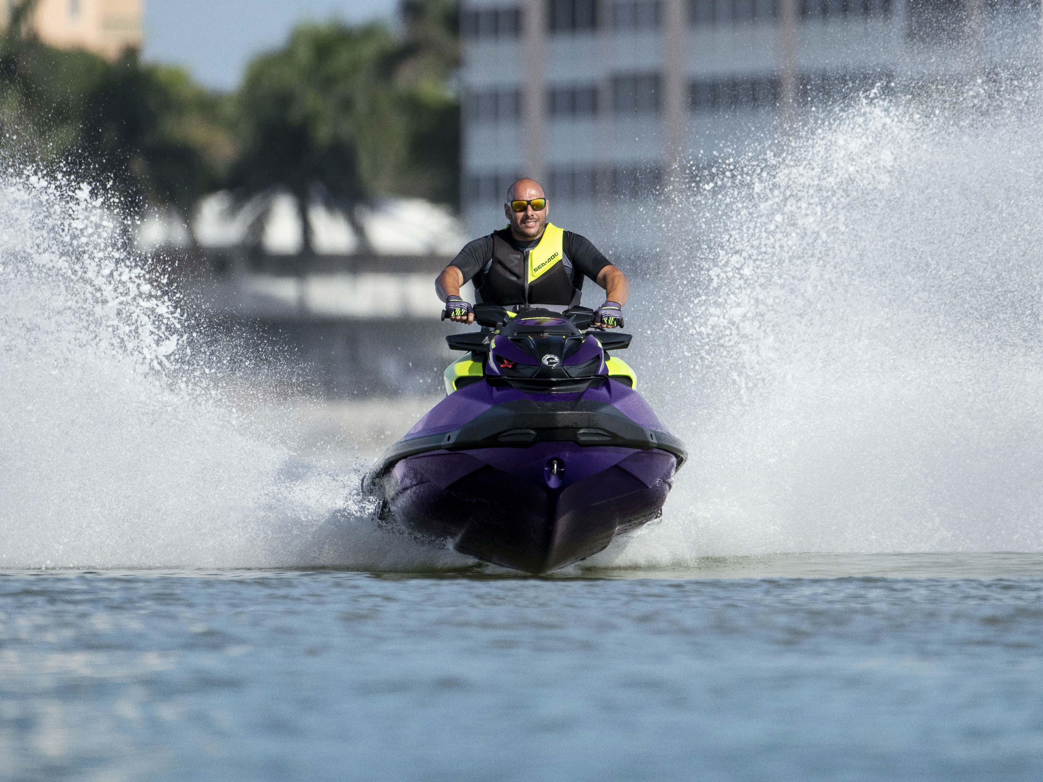 Man speeding a Sea-Doo RXP-X