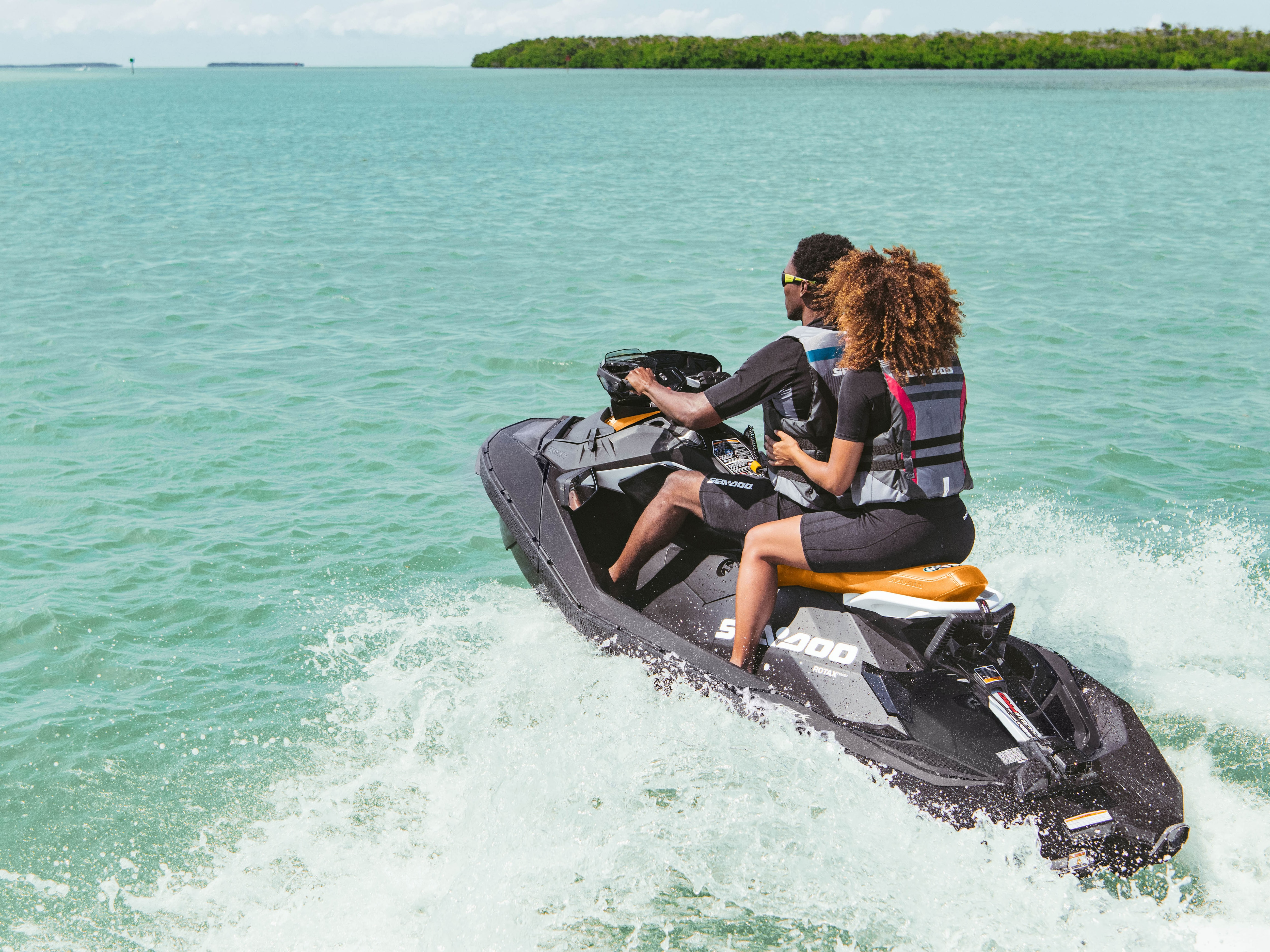 Couple riding a Sea-Doo Spark and enjoying a eco friendly pwc