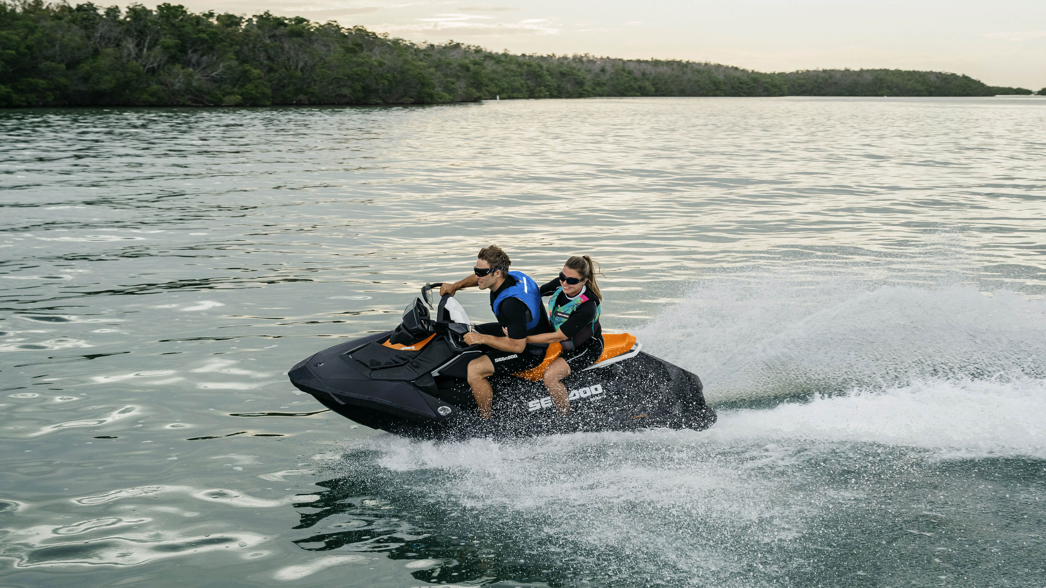 Couple riding a Sea-Doo spark with 2-3 seating feature