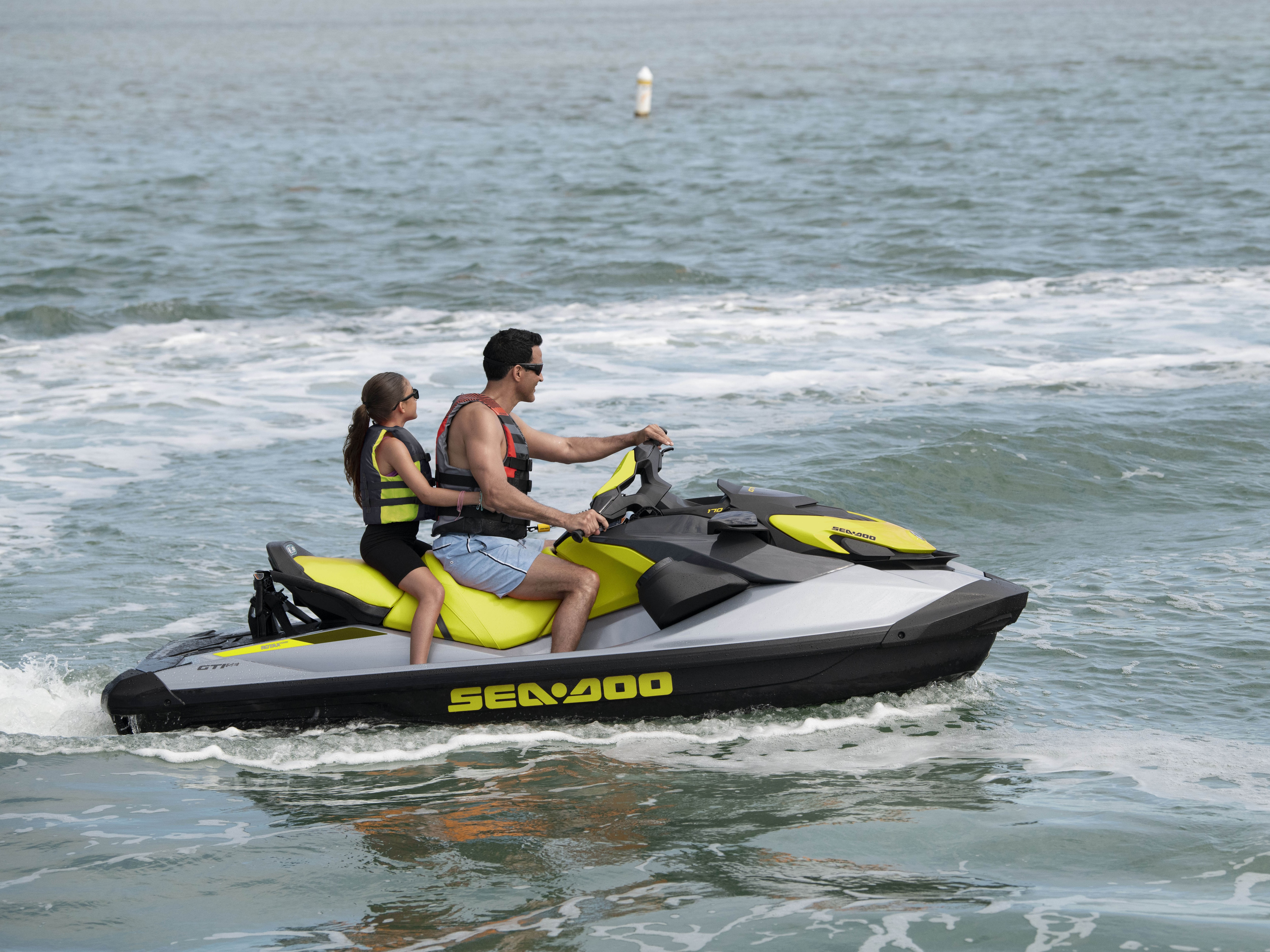 Couple riding a Sea-Doo GTI SE