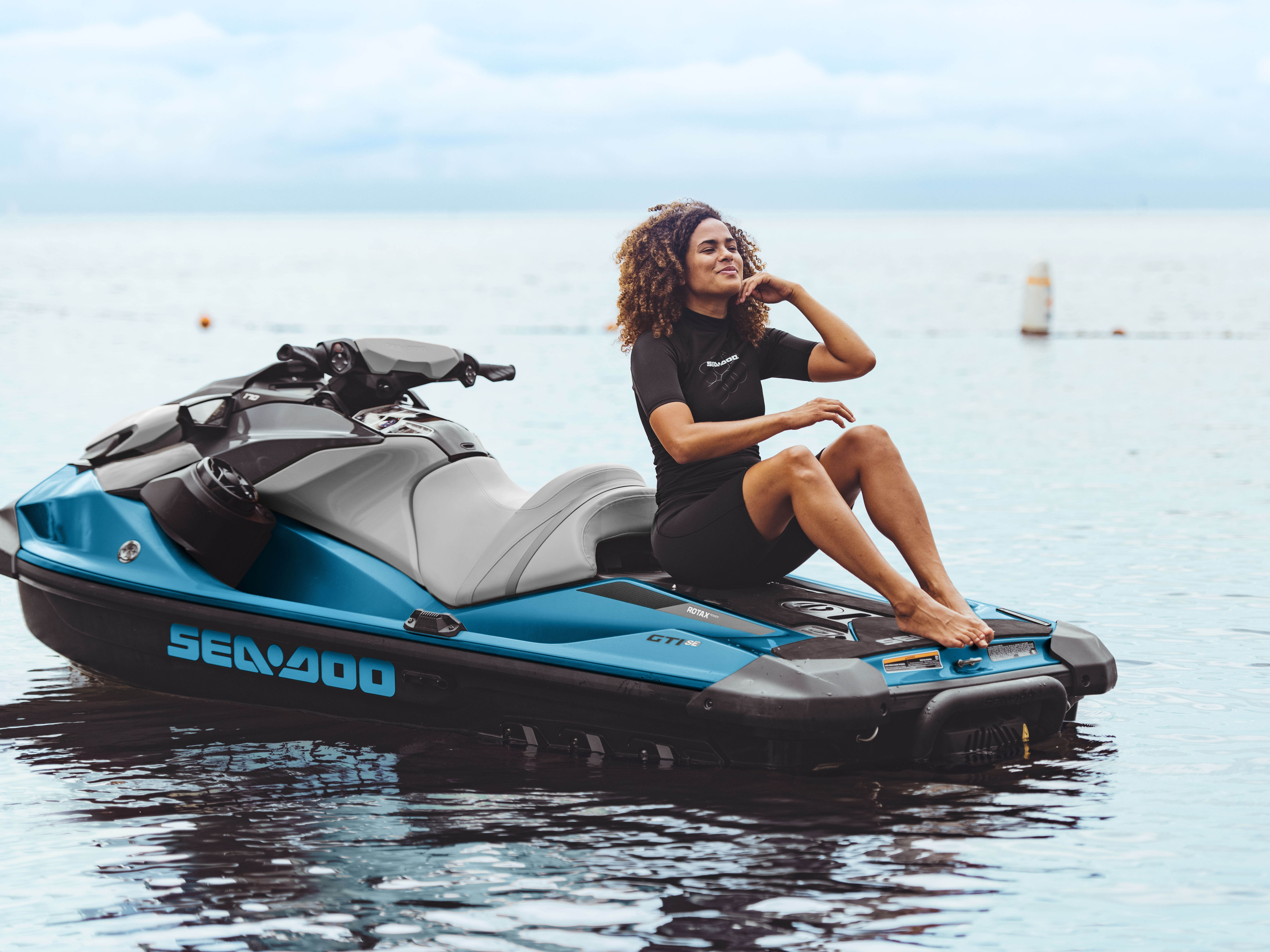 Woman siting on the Sea-Doo GTI SE large swim platform