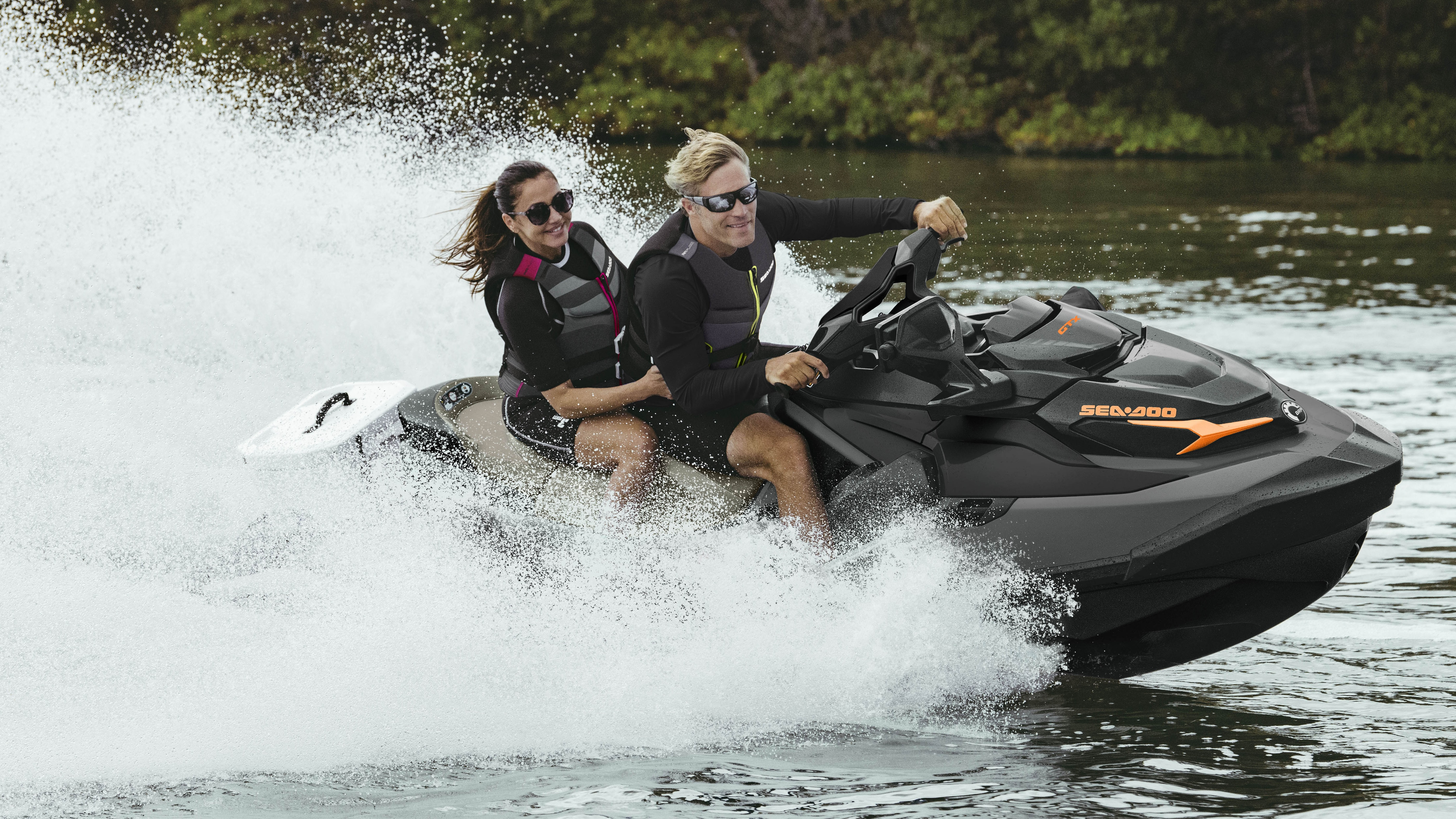 Couple riding a Sea-Doo GTX with the Cargo LinQ system