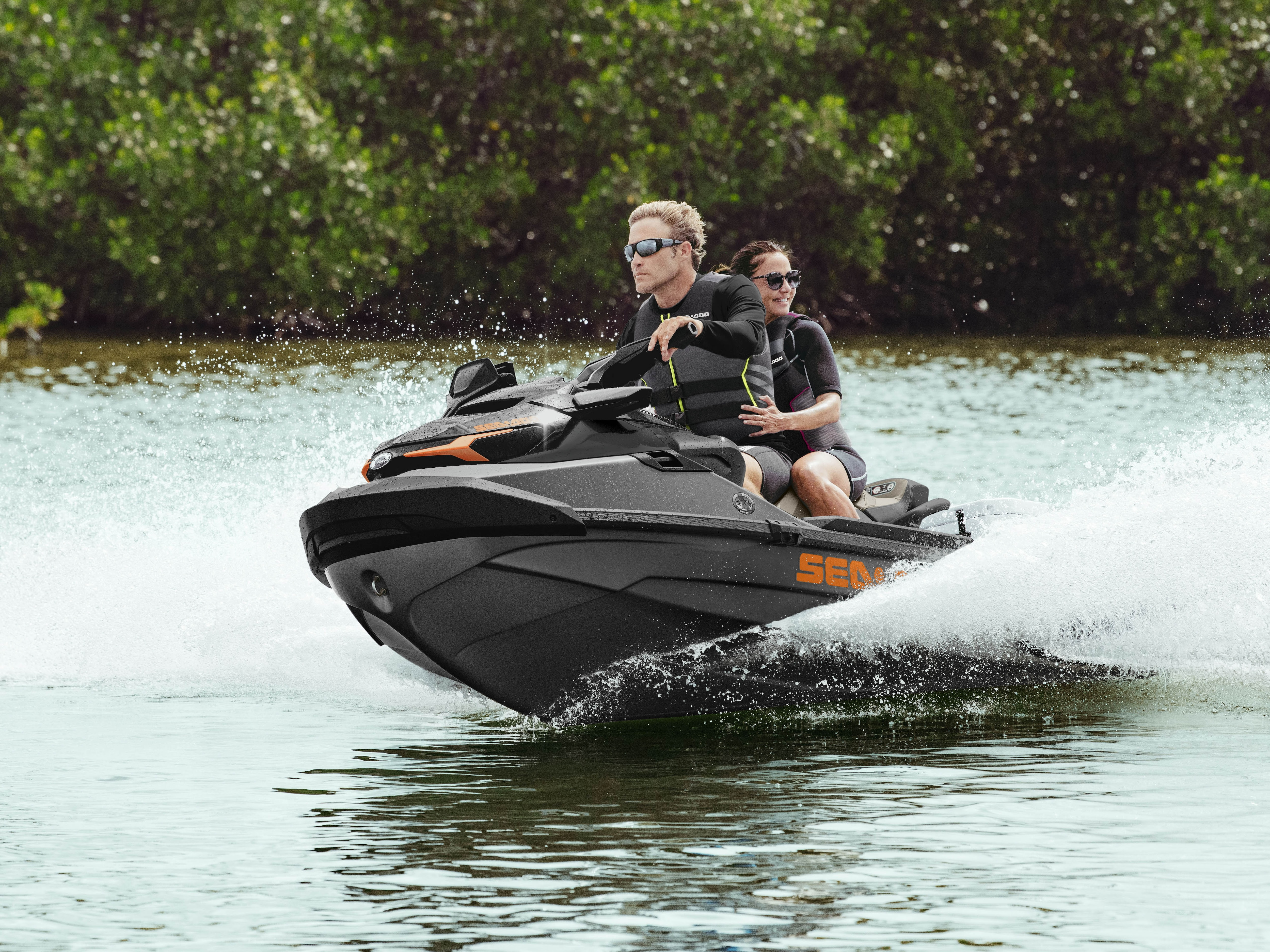 Couple riding a Sea-Doo GTX