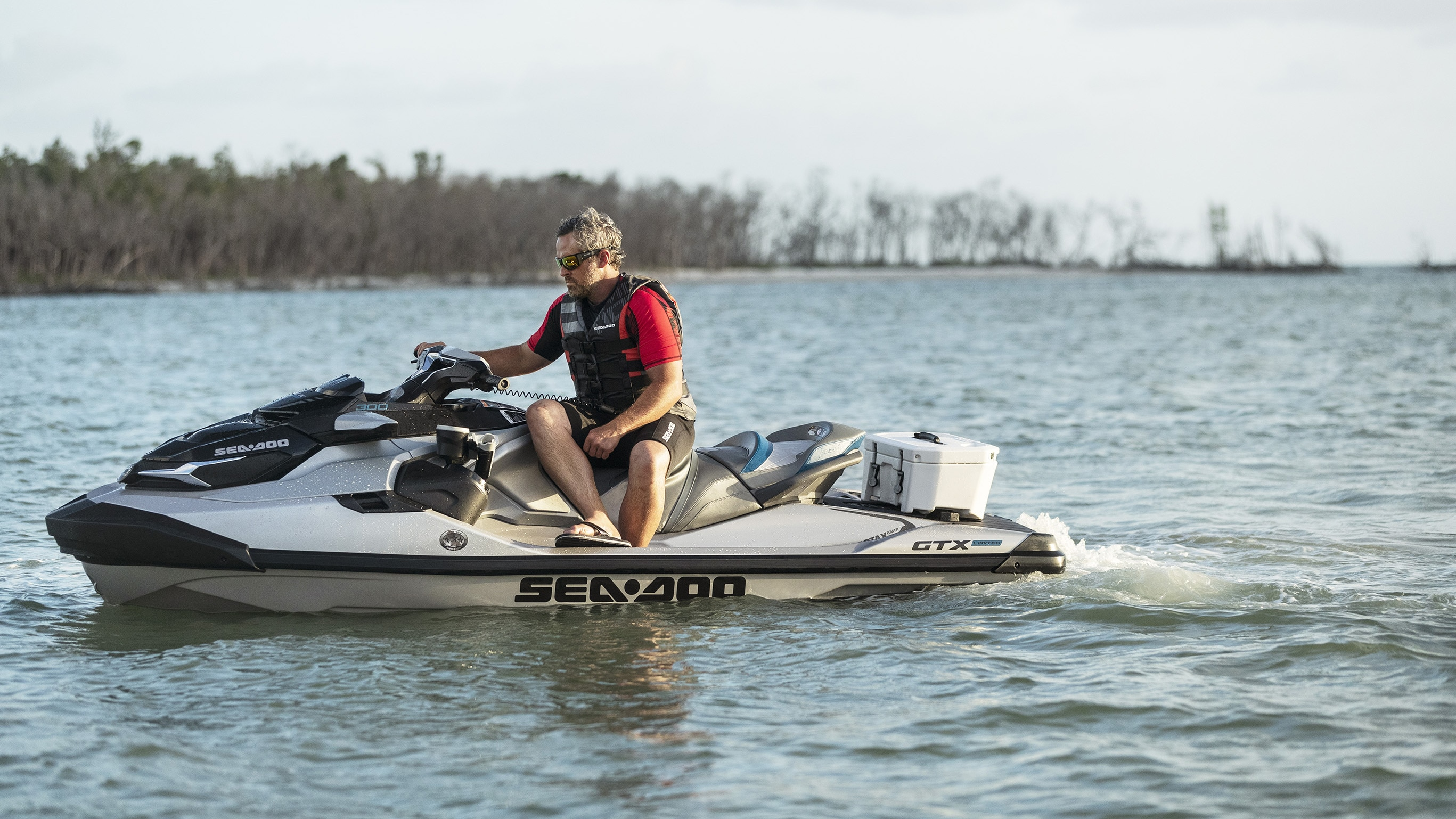 Man sitting on a Sea-Doo GTX with a LinQ box