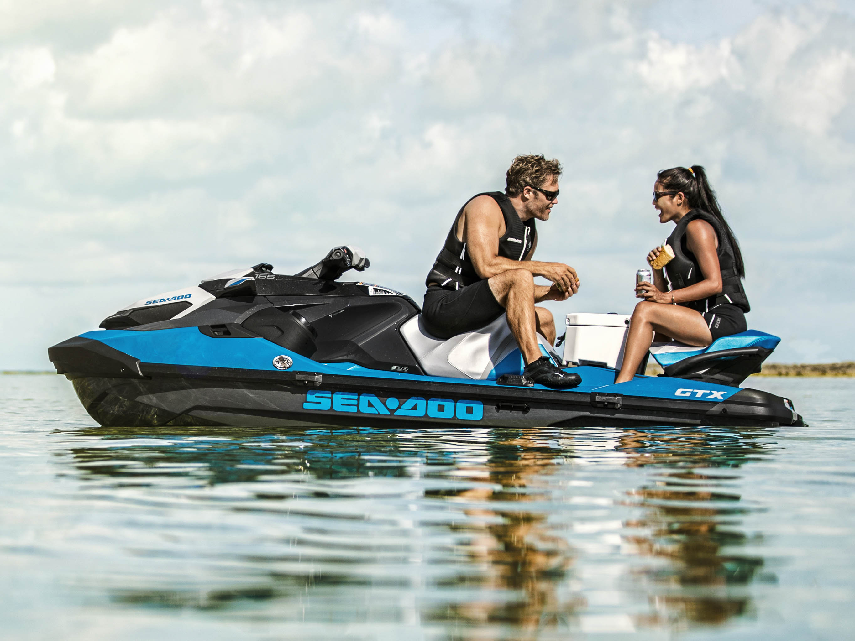 Couple eating on a Sea-Doo GTX