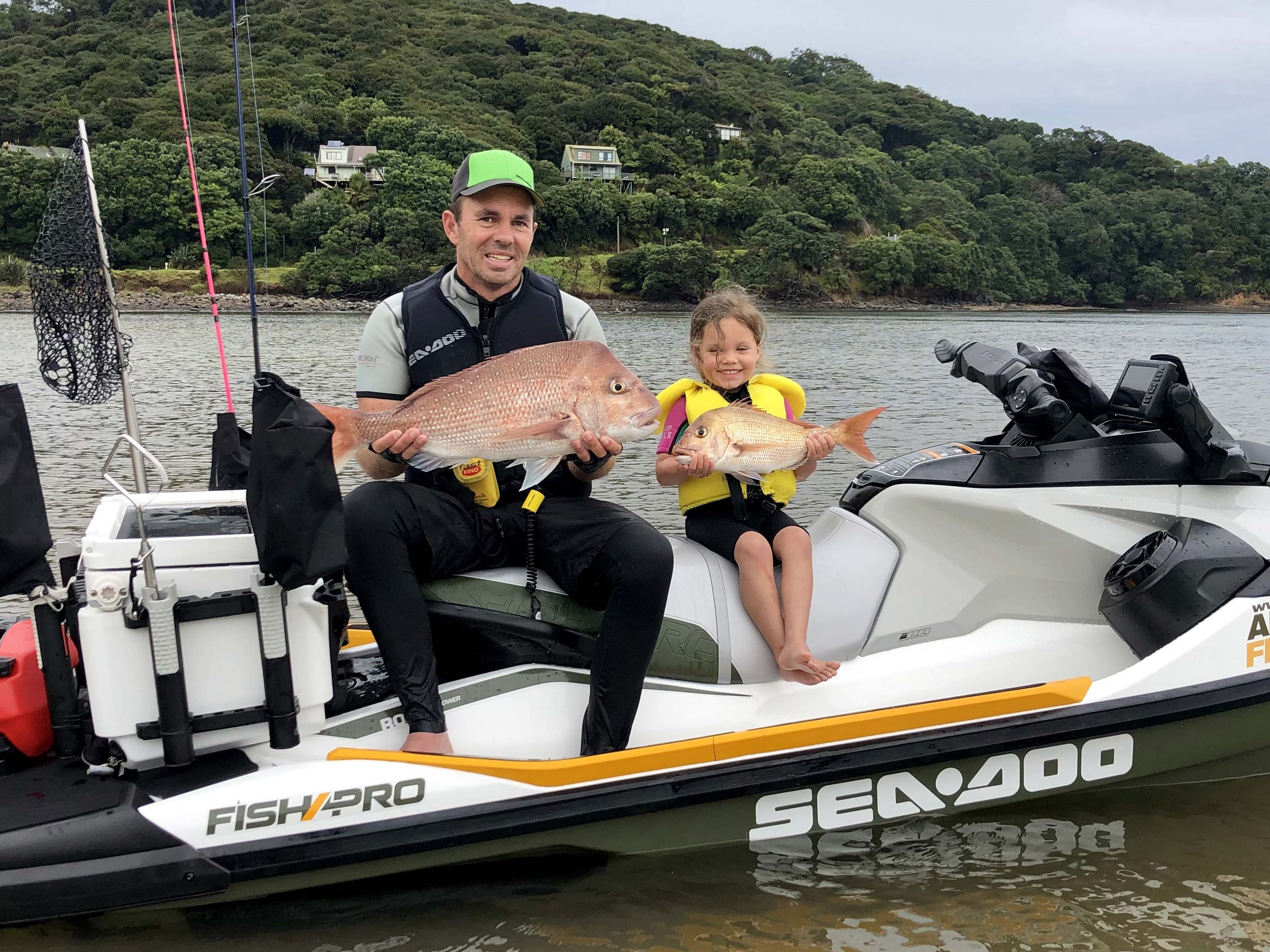 Andrew Hill fishing with his daughter