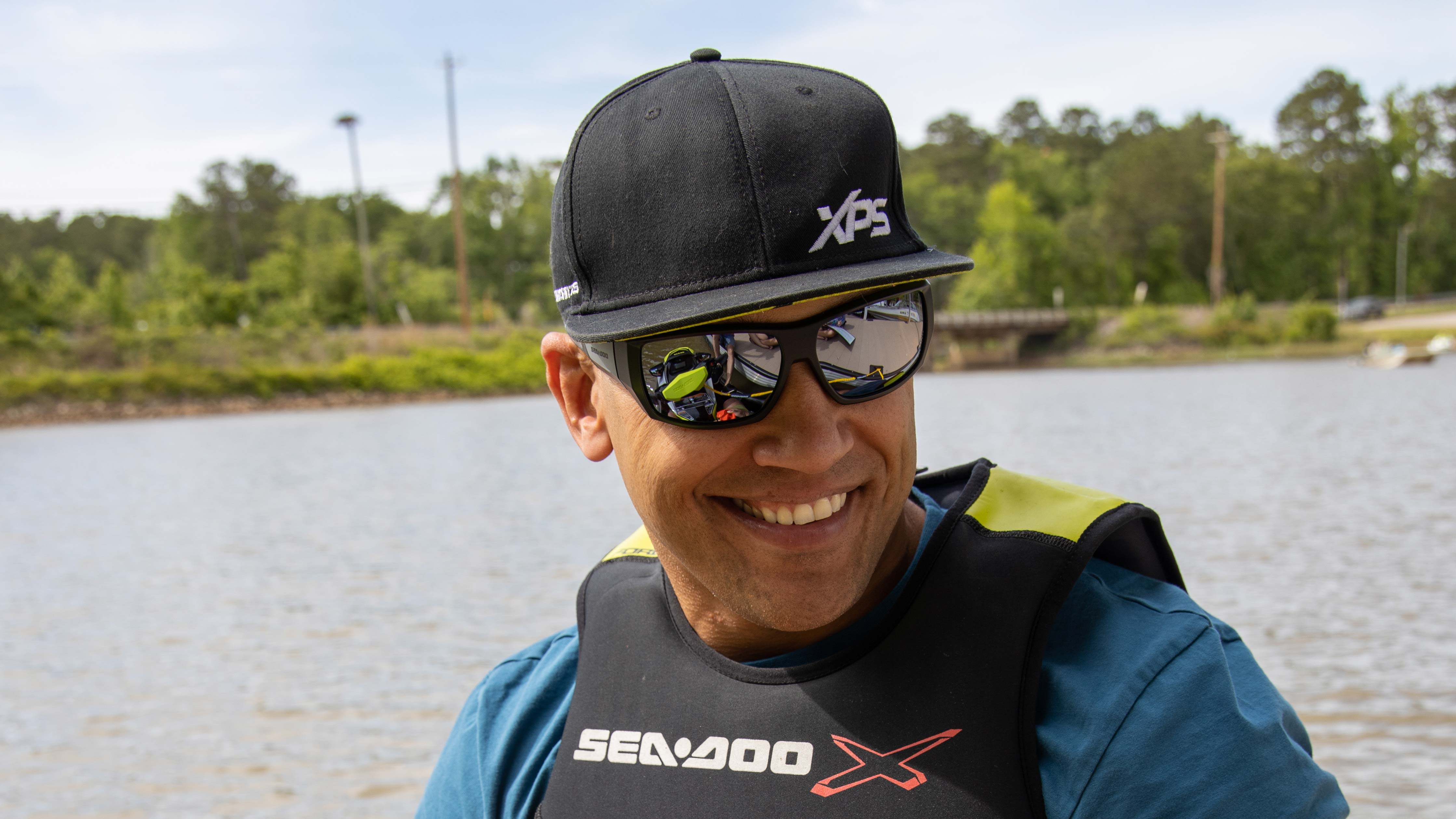 Anthony Radetic smiling with a XPS cap