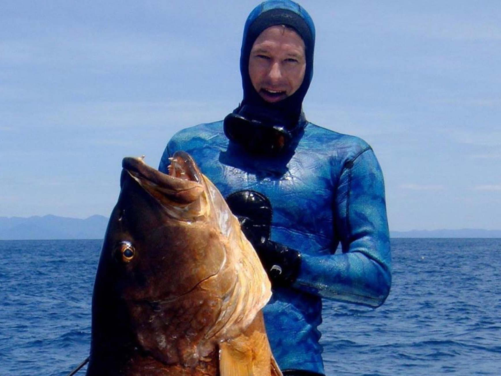 Cameron Kirkconnell posing with a big fish