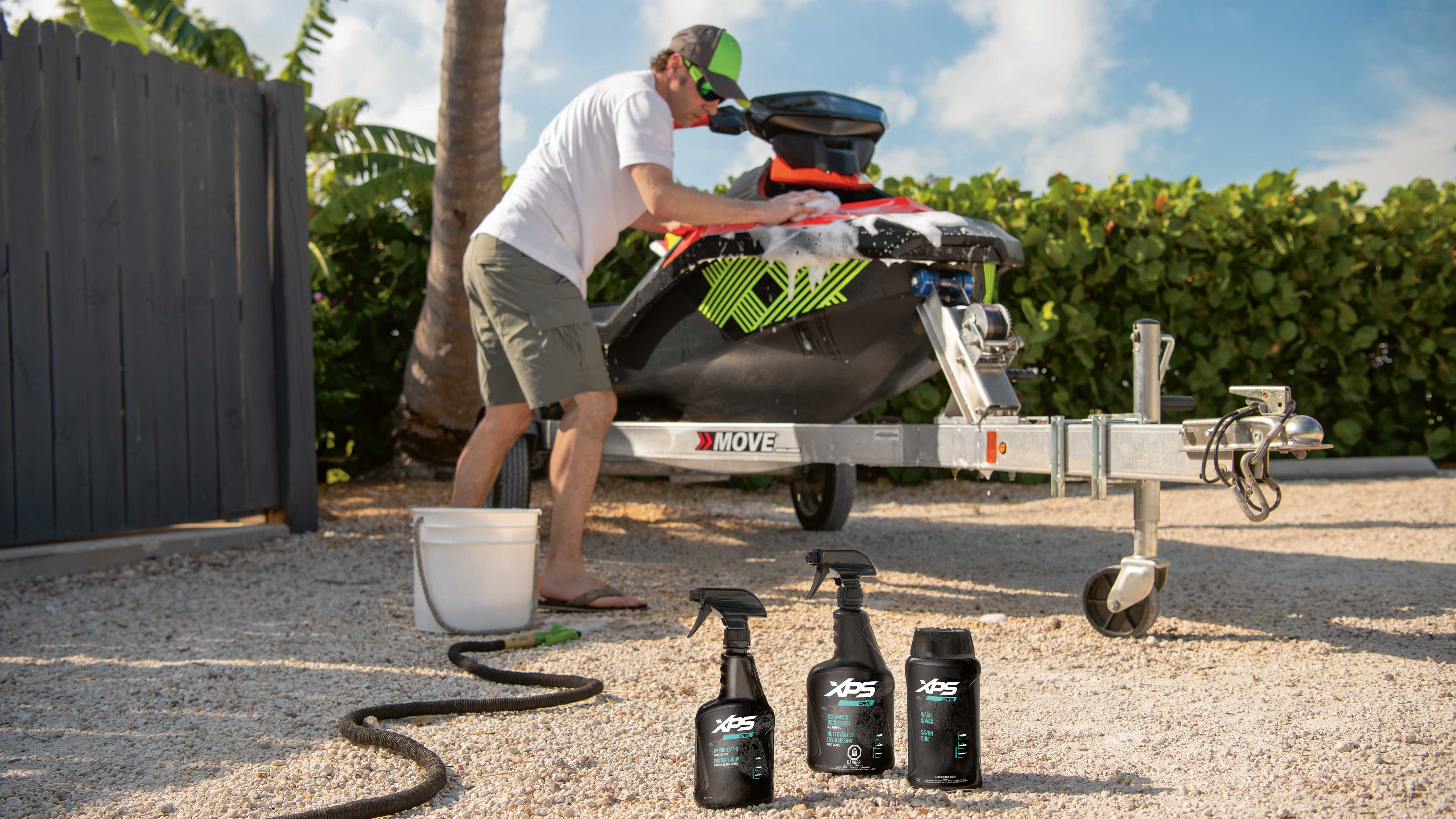 Men washing his Sea-Doo watercraft with XPS Care products