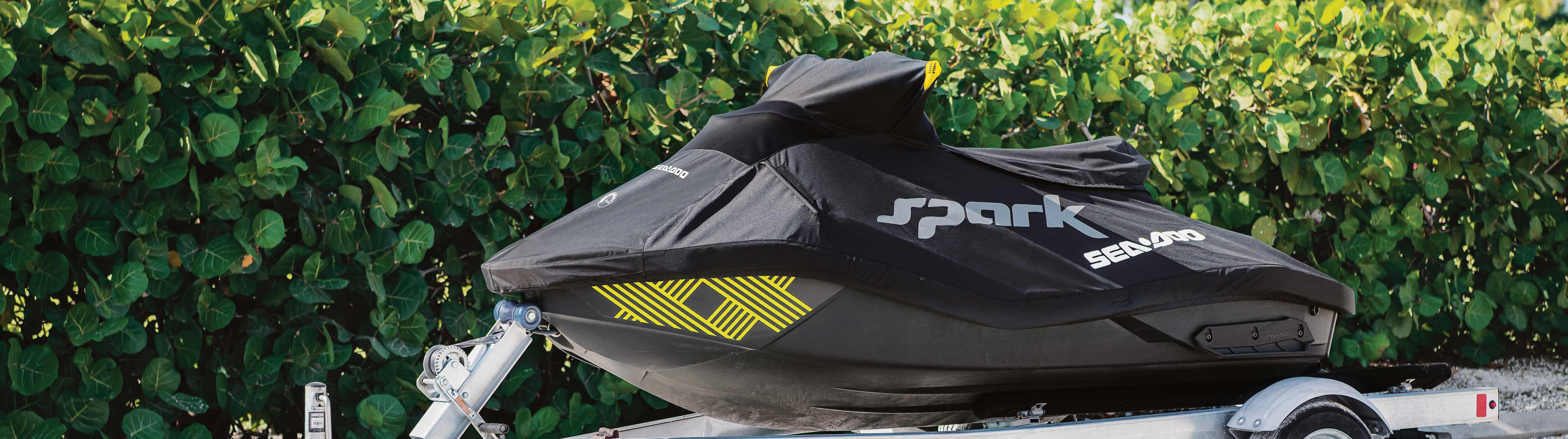 Sea-Doo SPARK with a Sea-Doo cover on a trailer