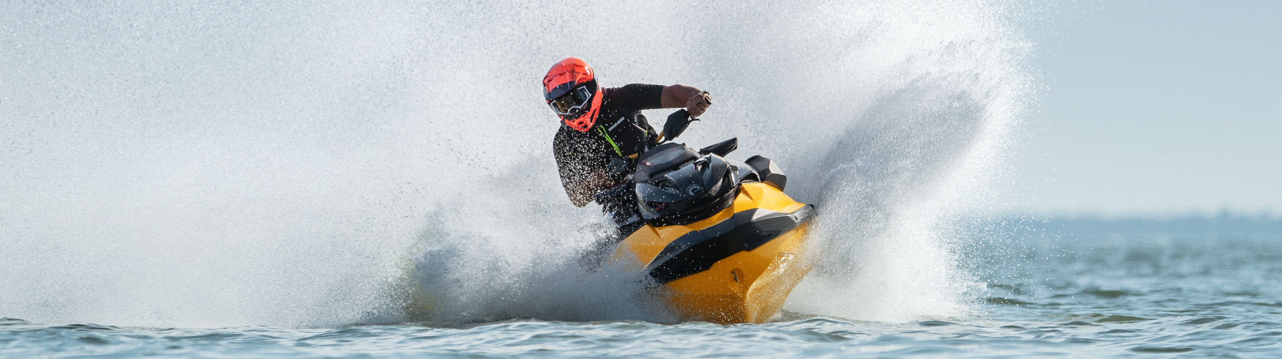 Men riding fast on his Sea-Doo RXP-X
