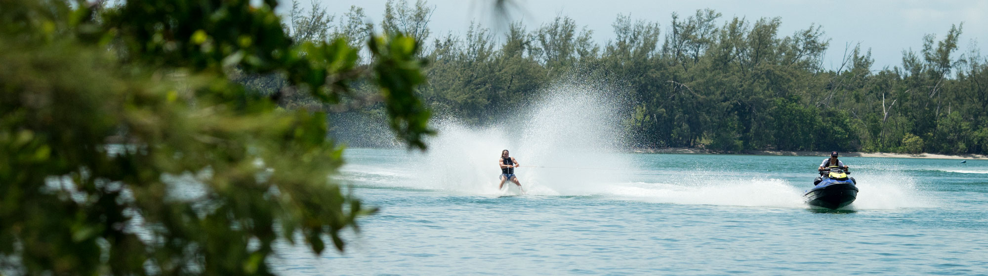Woman doing Wakeskate towed by a Sea-doo WAKE PRO