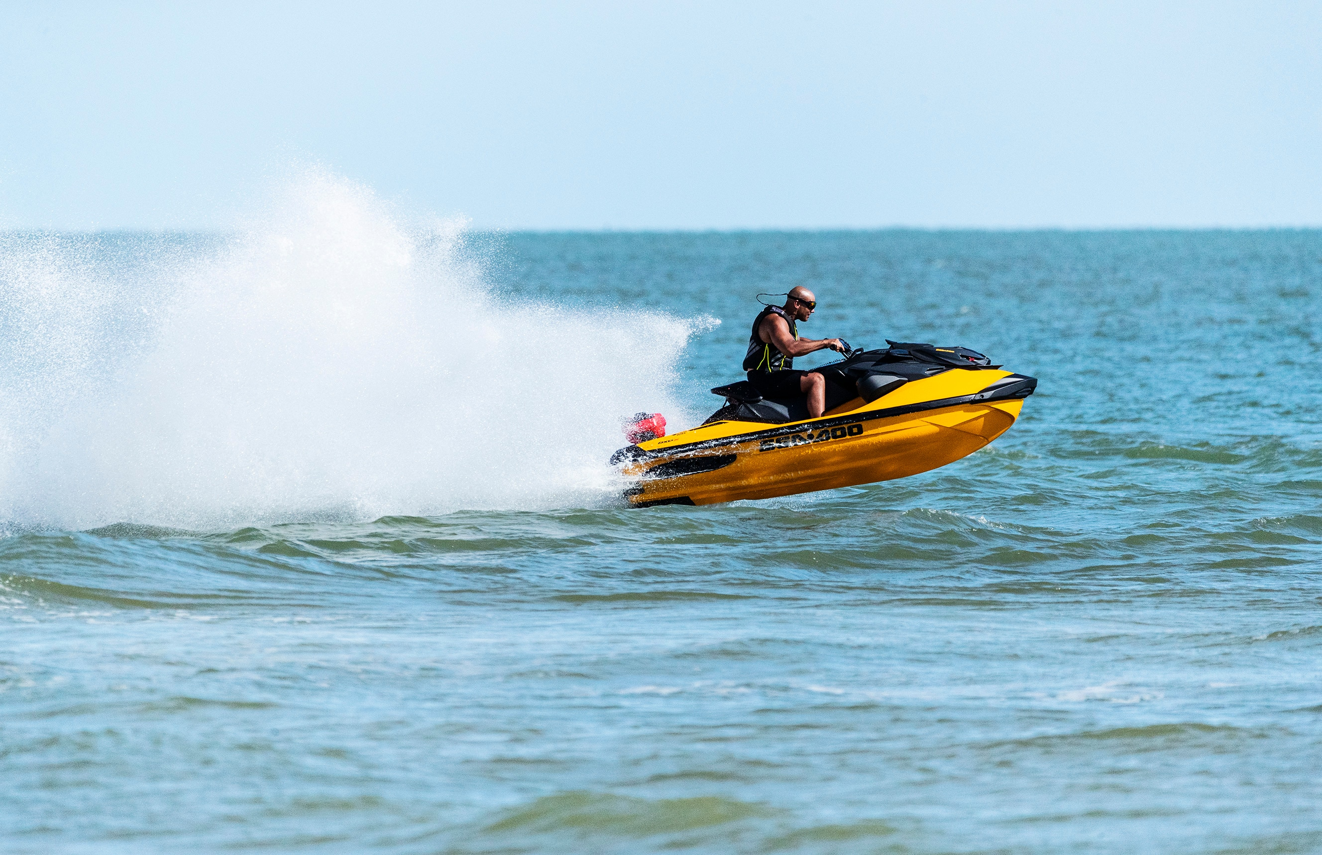 Man riding fast on a Sea-Doo RXP-X