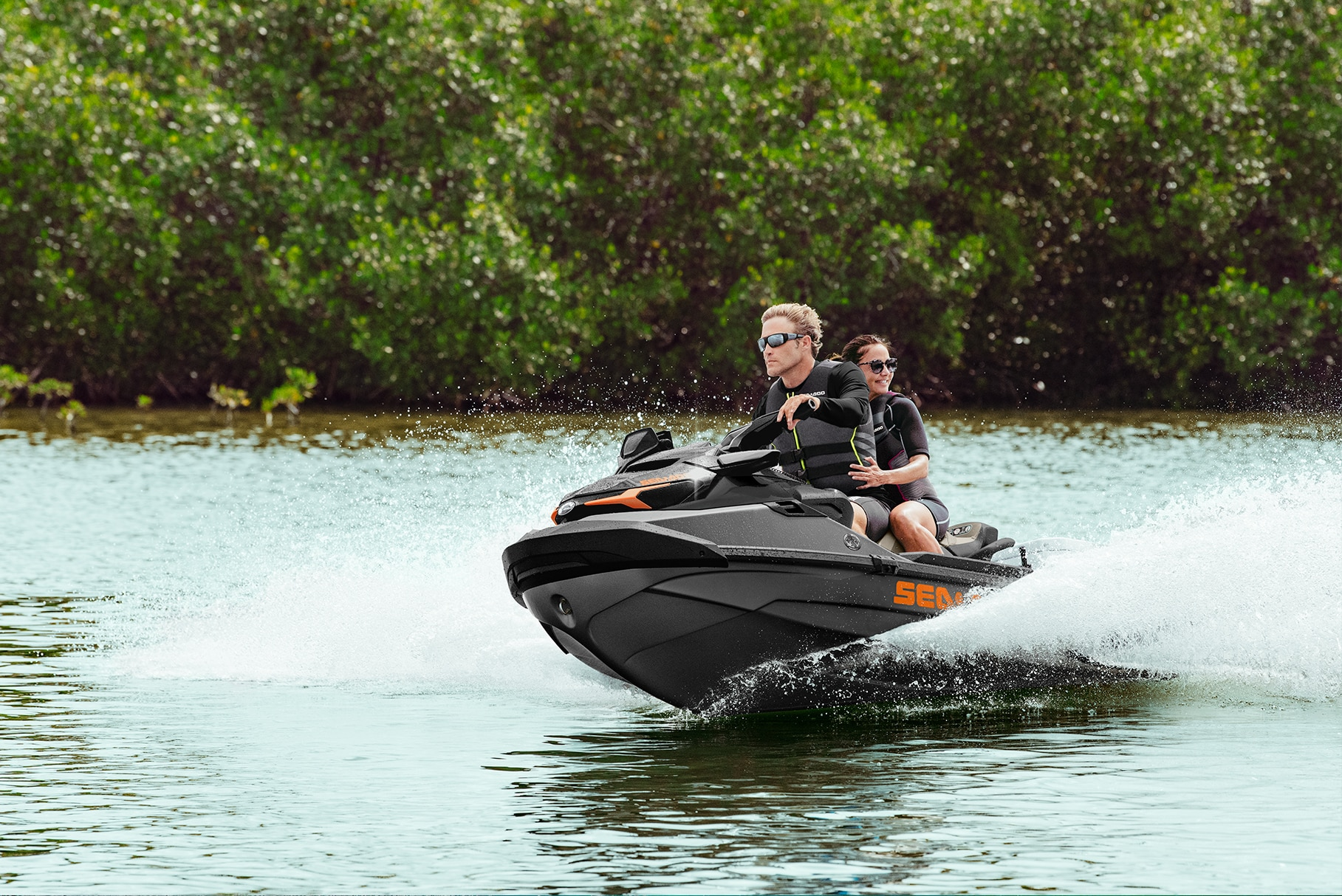 Couple enjoying their ride on a Sea-Doo