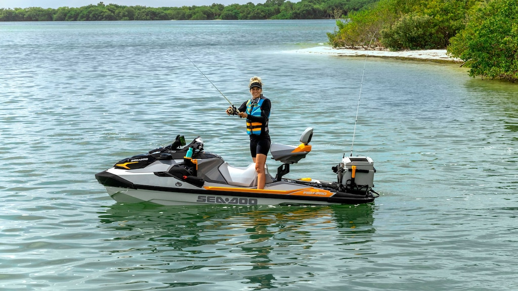 Woman riding her FishPro Trophy fullly equipped for fishing